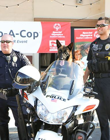 two policemen with their dog and motorcycle