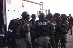 SWAT Team members in a briefing session